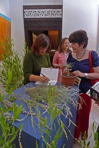 Dr Annette Patzelt signs her book